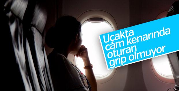 Uçakta cam kenarına oturmak gribe engel oluyor