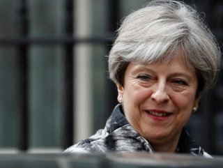 World expects May to announce the date of her departure