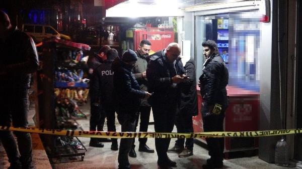 Bursa'da markete giren silahlı soyguncu kamerada
