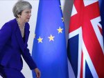 UK PM addresses Parliament after delaying Brexit vote