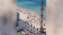 Plajdaki İsraillilerin sığınaklara koştuğu anlar kamerada
