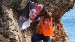 Antalya'da Atatürk posterini falezlere asmak isterken zor anlar yaşadı