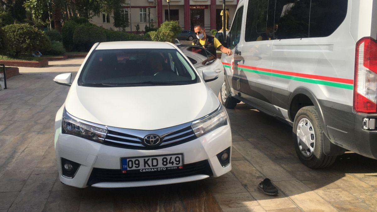 Aydın da uyuşturucudan tutuklanan şahıs, gazetecilere ayakkabısını fırlattı #3