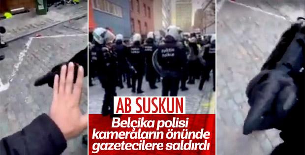 Belçika'da polisler basın mensuplarını tartakladı