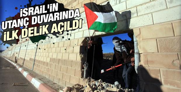 Filistinliler Ayrım Duvarı'na delik açıp bayrak diktiler İZLE