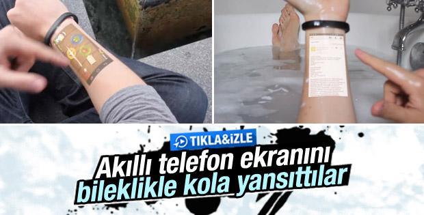 Akıllı bileklik Cicret telefon ekranını kola yansıtıyor