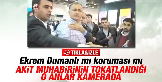 Ekrem Dumanlı'nın koruması TÜYAP'ta gazeteci tokatladı