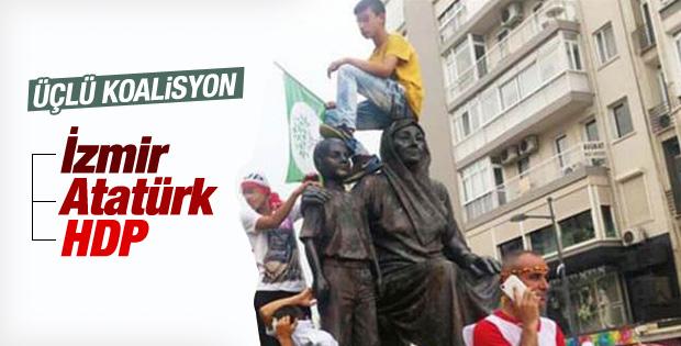 HDP'liler İzmir'de Atatürk heykelinin üzerine çıktı