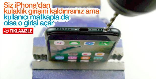 iPhone 7'ye matkapla kulaklık girişi açan adam