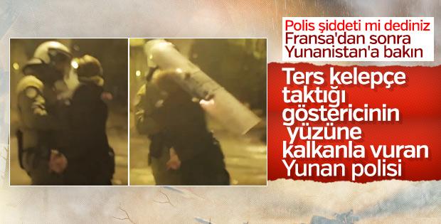 Yunan polisi protestocuya kalkanıyla vurdu