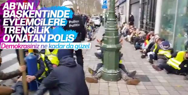 Belçika polisinden göstericilere ters kelepçeli eziyet