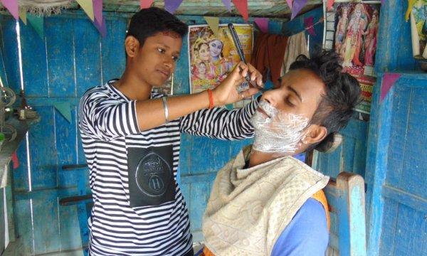 2 sisters, men dressed as 4-year-old barbers