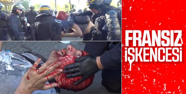 Fransız polisi göstericinin kafasını jopladı