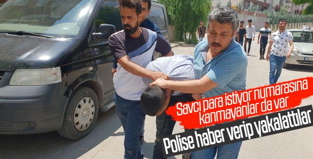 Sahte polisi dilenci kılığı ile yakaladılar