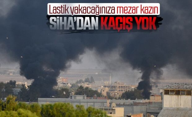 YPG'li teröristler SİHA'lara karşı lastik yakıyor