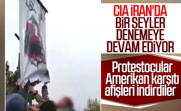 İran'da Amerika'ya tepki için verilen afişi indirdiler