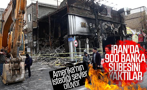 İran'da göstericiler 900'den fazla bankayı yaktı