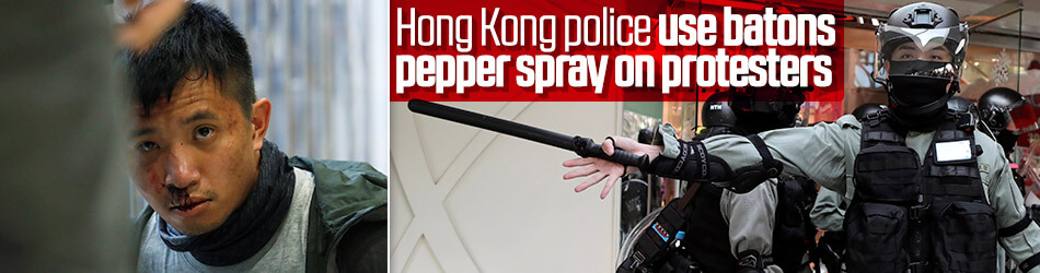 Hong Kong police beat protesters in shopping mall