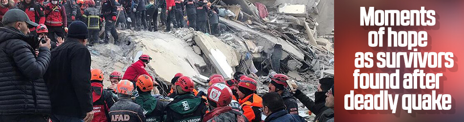 Rescue teams search for trapped earthquake survivors
