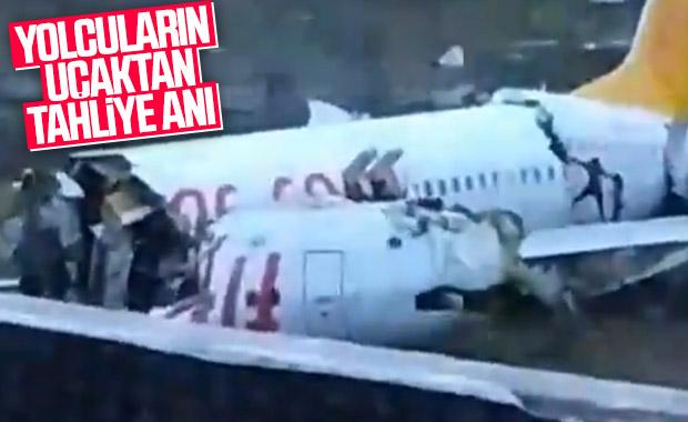 Kazanın ardından uçaktan çıkan yolcular