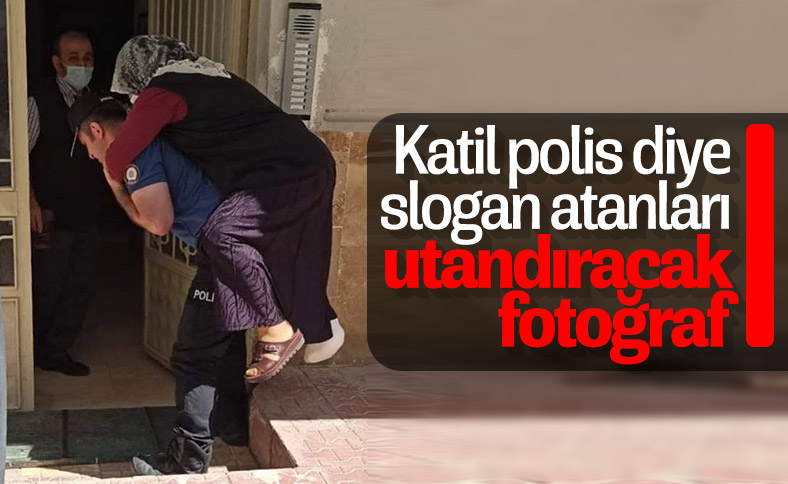 Ayağı kırılan kadını sırtında taşıyan polis