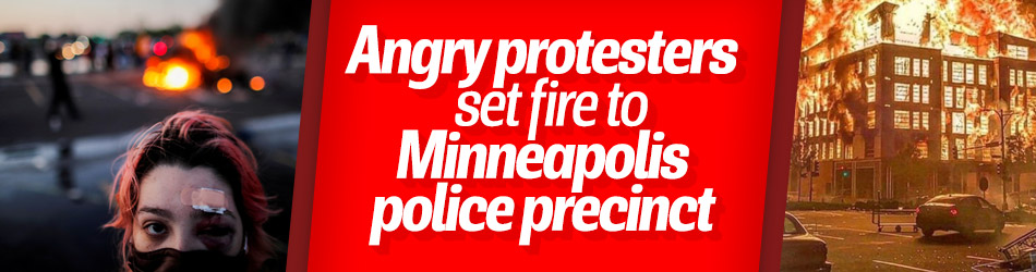 Angry protesters set fire to Minneapolis police precinct