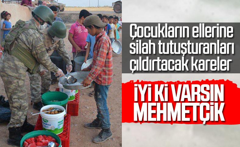 Türk askeri yemeğini Suriyelilerle paylaşıyor