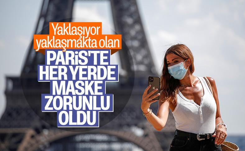 Paris'te artık açık alanlarda da maske takmak zorunlu