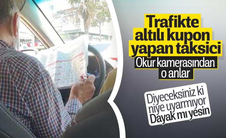 İstanbul'da araç kullanırken at yarışı oynayan taksici pes dedirtti