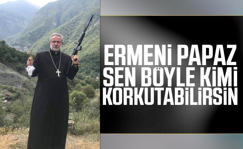 Ermenistan'dan silahlı ve haçlı papaz paylaşımı