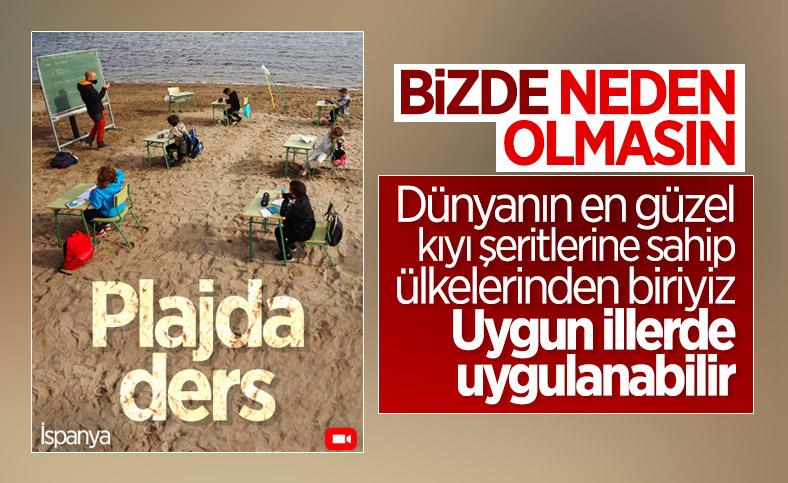 İspanya'da öğrenciler, plajda ders yaptı