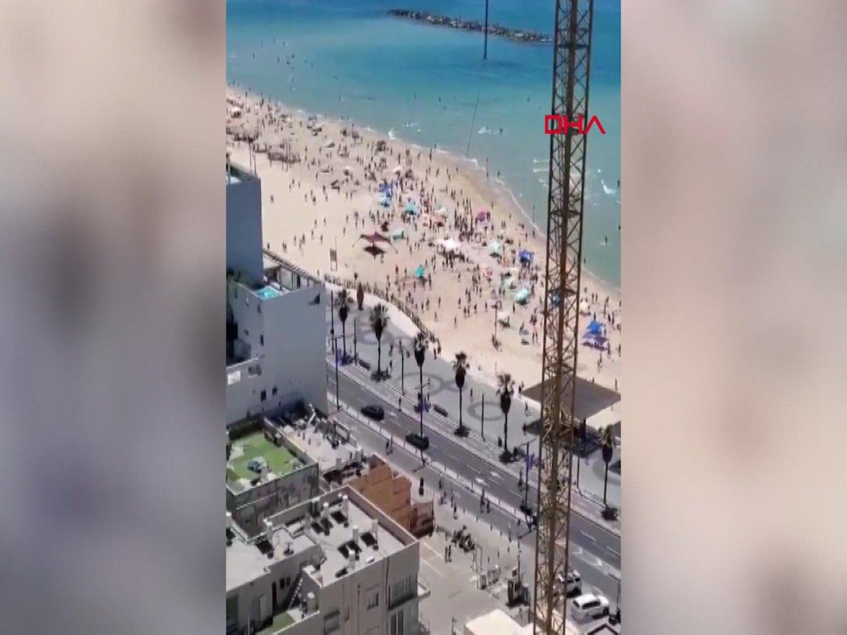Plajdaki İsraillilerin sığınaklara koştuğu anlar kamerada #3