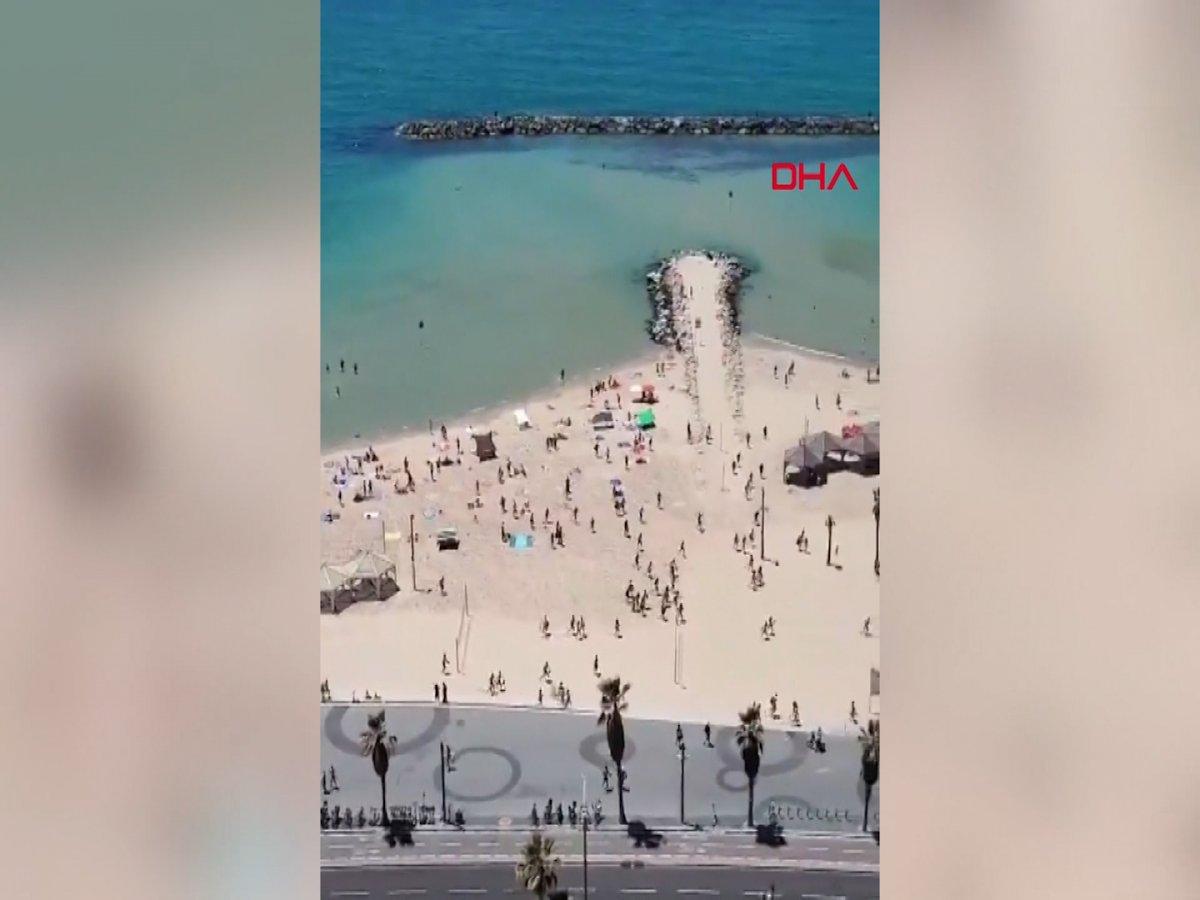 Plajdaki İsraillilerin sığınaklara koştuğu anlar kamerada #2