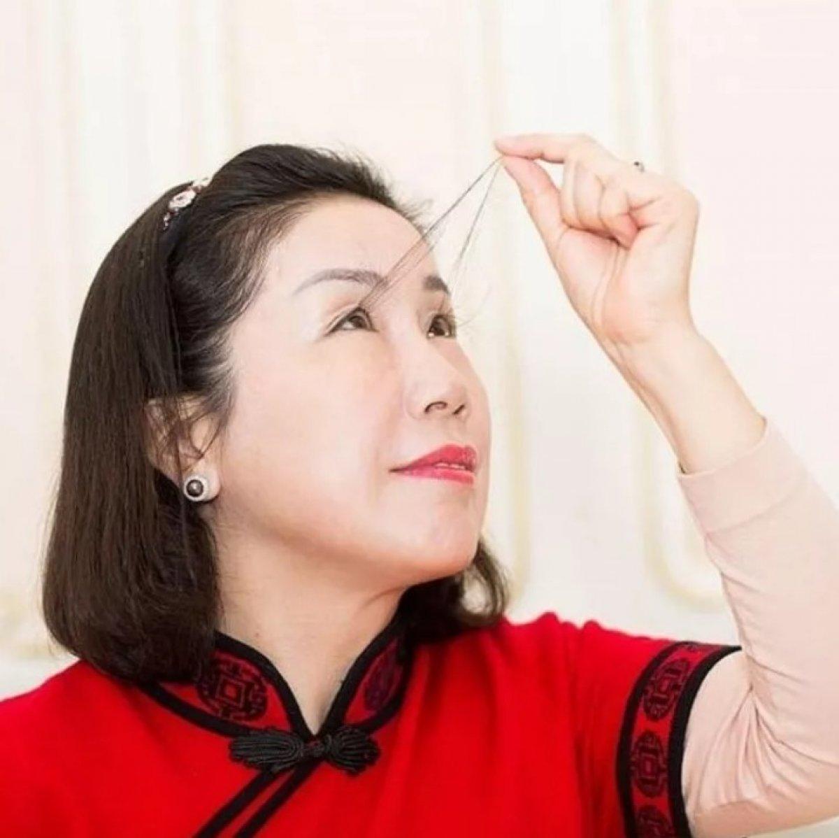 Çinli kadın kirpikleriyle ikinci kez dünya rekoru kırdı #5