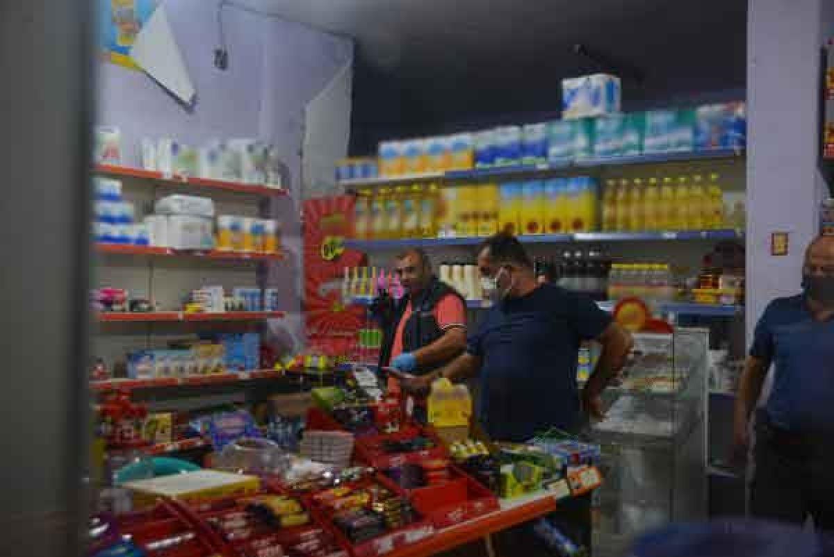 Adana da bakkal, yüzü maskeli biri tarafından silahlı saldırıya uğradı #1