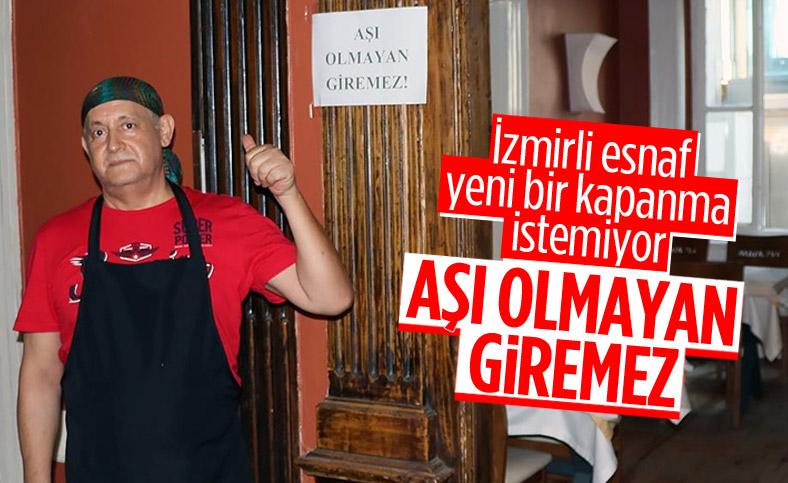 İzmir'de esnaftan müşterilerine aşı şartı