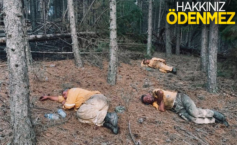 Kahraman personeller, yangını söndürdükten sonra toprakta uyudu
