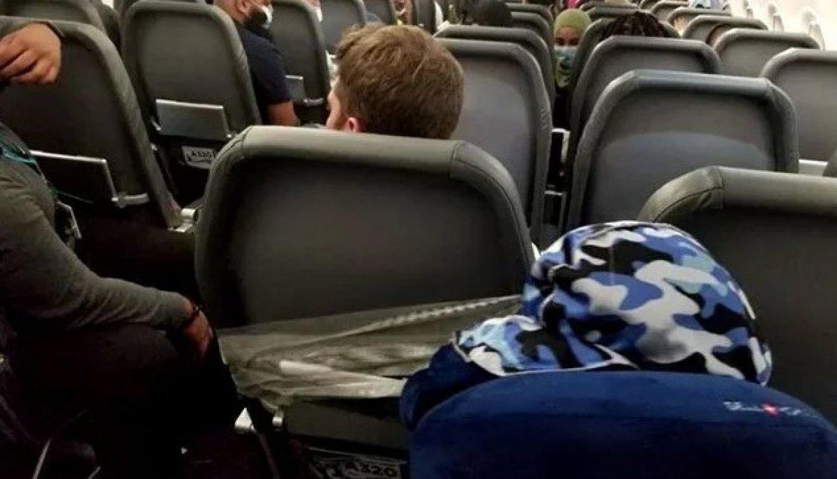 ABD'de uçakta hostesleri taciz eden yolcu, koltuğa bantlandı #1