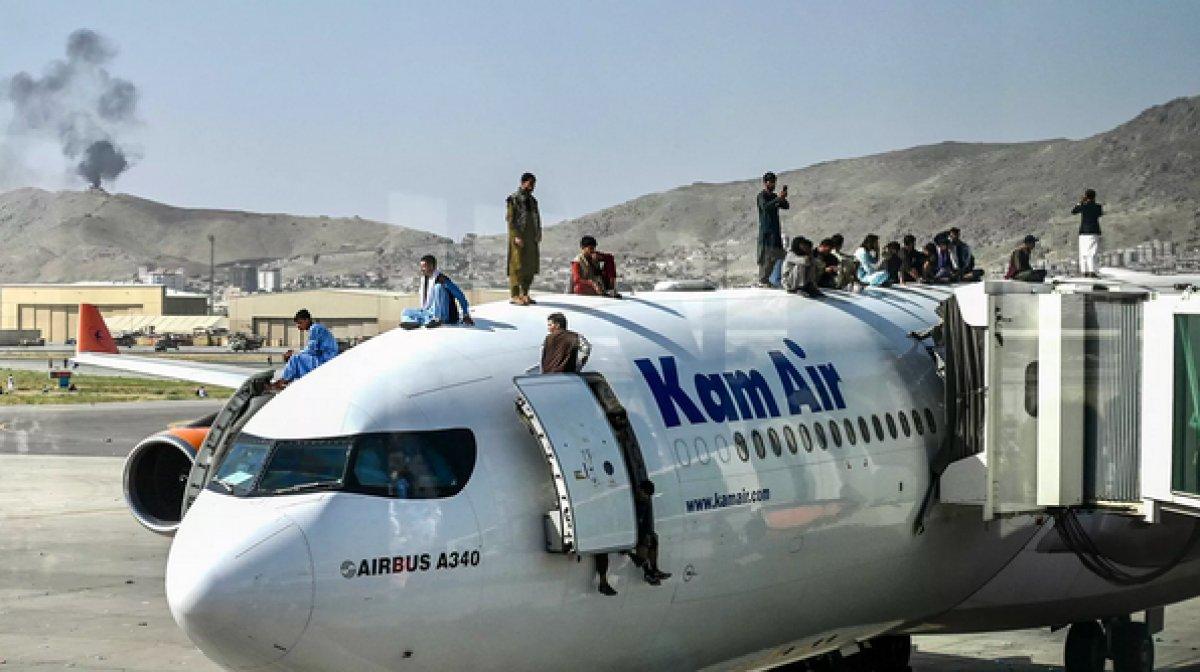 Afganistan da uçaktan düşen insanların resmedildiği tişörtler ABD de satışta #4
