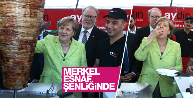 Merkel esnaf şenliğinde döner kesti