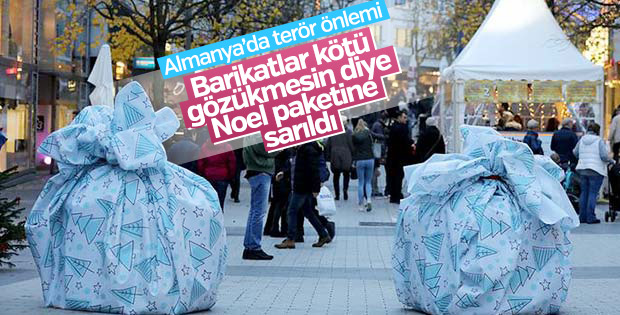 Almanya'da terör bariyerlerine hediye paketi kamuflajı