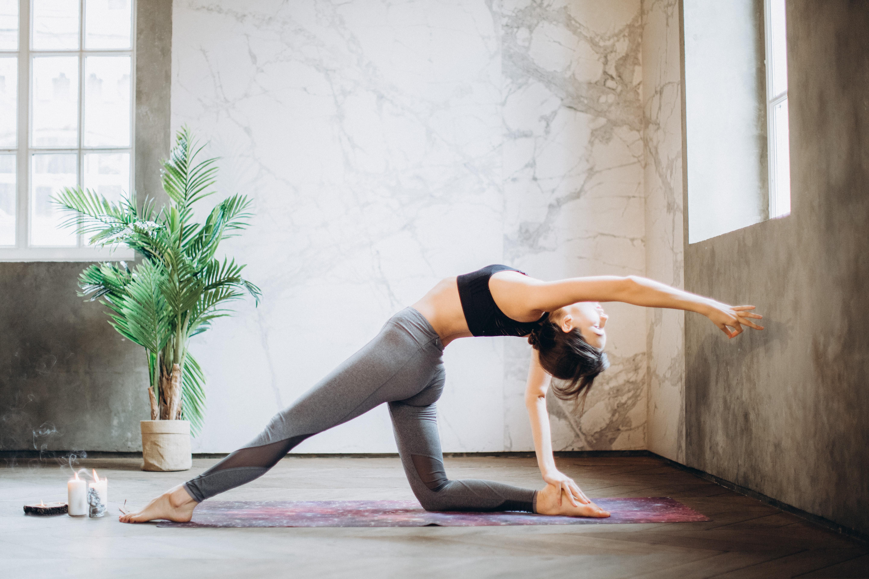 woman in gray leggings and black sports bra doing yoga on 3823039