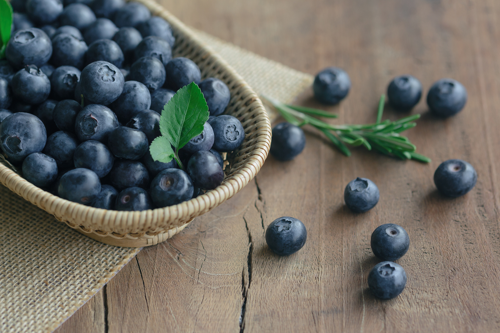 bigstock Fresh Wild Blueberries In Wood 233839492