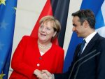 Greek PM asks Merkel to negotiate on reparations