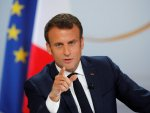France cannot accept every refugee, Macron says